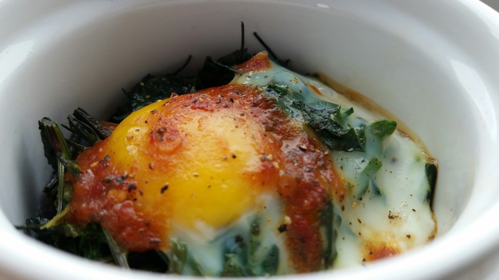 Baked Eggs with Lambsquarters and Harissa